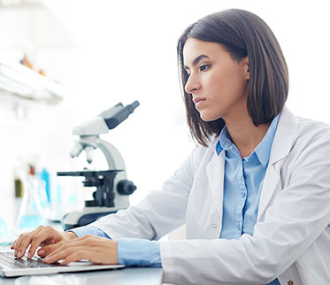 Clinician working on computer in a lab